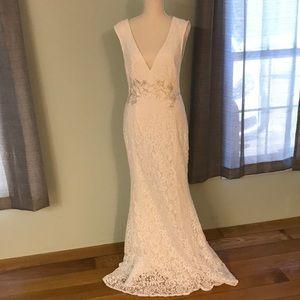 "White lace-like floor length ""wedding"" dress"